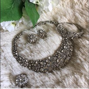 Statement necklace, bracelet, ring and earrings.